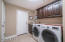 Custom cabinets and laundry room sink.