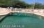 Sparklying fenced pebbletec pool