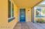 Front door with accent windows