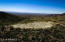 Stunning view of the forest and mountain to the North and a 360 degree panorama from the enormouse flat area at the Northern end of the property. Its a cleared area the size of a football field, perfect for a home or many other uses. Note the size of the Hummer parked there.