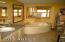 Master bathrom with large tub. To the right is a shower and flush toilet. The home is on a septic system and has a well.