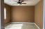 Guest bedroom with walk in closet and separate bathroom
