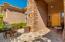Travertine pavered courtyard entrance.