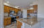 Kitchen with breakfast bar, granite counters, stainless appliances