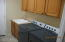 One side of laundry room with large capacity W & D