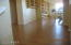 Upstair Loft area & flooring. Built in shelving all stays, but large sewing equipment does not.
