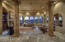 Oversized living room with refrigerated wine cellar, beautiful tiled floors, coffered ceilings, gas fireplace!