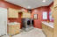 Laundry room with cabinets, counters, sink, gas or electric attachment; freezer plug-in