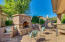 Exterior fireplace-Notice Fruit trees and garden space behind