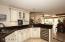 Kitchen has custom cabinetry, wine fridge, undermount lighting & quartz countertops!