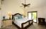 Master bedroom features vaulted ceiling.