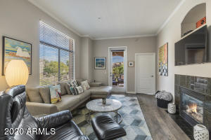 Engineered hardwood flooring, two tone paint and crown molding give this great room a luxurious feel.