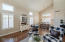 Spacious Living Room/Dining Room with vaulted ceilings and hardwood floors