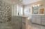 Elegant master bathroom with custom tile and vanity.