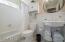 1sr floor bathroom (#3) with custom tile and pedestal sink.