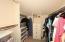 Walk-in closet in second bedroom.