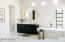 Master bath with his/hers water closets and vanities