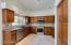 Pot shelves around kitchen
