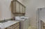 Laundry room with refrigerator, sink & extra cabinetry
