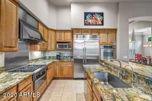 Beautifully updated kitchen offers ample counter space and storage.