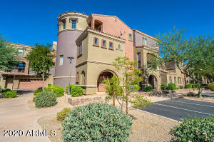 Amici floorplan with premier interior location overlooking green space & community pool & BBQ area. All one level & offers open floorplan. Kitchen upgraded with custom cabinetry, granite counters w/ tile backsplash, stainless steel appliances including wine fridge. Chiseled Travertine flooring in main areas. Upgraded baseboard & crown molding throughout. Guest bath w/ granite counters & tile surround at shower. Master features wood laminate flooring. Stunning master bath with travertine surround at shower & granite counters. Walk-in with built-ins. Functional laundry with counter & cabinetry. Surround sound throughout & ceiling fans. This is a very desirable gated community. Community center features clubhouse with fitness center. Tennis courts, basketball courts, sand volleyball and rock climbing wall. Main pool features lanes for lap swimming plus recreational swim. Villages has own pool with outdoor grilling area & fireplace. Bike and walking paths throughout community. Close to schools, shopping, dining and nightlife. Just 30 minutes to Sky Harbor Airport and 5 minutes from Mayo Hospital.