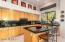 Very large kitchen w/island seating and breakfast nook. Views.