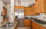 Kitchen With SS Appliances and Gas Cooktop
