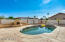 Pool with outdoor fireplace and seating