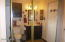 Third bath with large, deep mirrored door closet