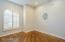 Den with hardwood flooring