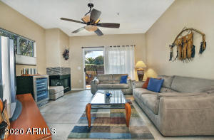 Superb poolside location! This generously sized ground floor unit has no stairs and an attached garage. Meticulously maintained and recently upgraded. Features include Tile and laminate wood flooring, wood burning fireplace, Trane HVAC, wooden blinds throughout. The oversized patio is a true extension of the living space. Scottsdale Mission features resort style pool area, tennis court and workout room. Easy access to the 101 and tons of shopping and restaurant options in the area.
