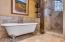 Upper level claw bathtub