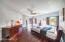 Spacious Master features beautiful hardwood floors and striking views.