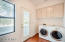 Laundry with closet and cabinets