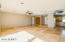 White front door, travertine floors, Great Room and Kitchen