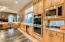 Double ovens, beverage/wine center, and ice maker is to the left of the beverage center.
