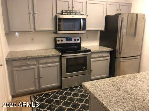 Settle down right in the heart of Scottsdale. Fully upgraded 2 bedroom, 2 bath condo with private patio.  Wood plank tile throughout for a seamless look. New granite in kitchen and baths as well as a stainless steel refrigerator. Laundry room, wood burning fireplace adjacent to both dining room and family room. The Mission has wonderful amenities...pool and tennis courts as well as covered parking.