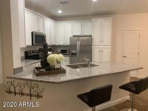 Kitchen cabinets just all refinished in antique white with beautiful designer hardware