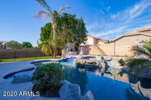 Oasis heated pool and spa with firepit, in-pool table and baja step.