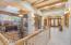 Dramatic Foyer and Details including Alder Doors, glass, Viga Beams, Travertine