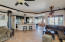 Open kitchen/family room. Columns inset with stone and light up.