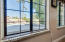 Enjoy morning coffee looking out onto the lake view. Granite window sills.