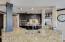 Oversized granite kitchen island with live edge. Woven travertine backsplash.