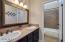 Upstairs hall bath with double sinks.