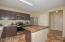 Granite countertops; stainless steel appliances; butcher block island