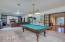 Huge bonus/game room w/ new carpet, fireplace & built in shelving. Pool table conveys.