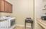 Laundry Room with upper cabinets and storage space