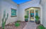 Courtyard with beautiful landscaping and paver walkway to front door