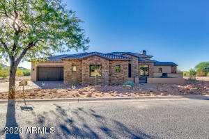 Completed new build in the highly acclaimed Superstition Mountain subdivision. 3794 square feet of pure quality through out! 3 bedrooms, 3.5 baths, 3 car garage, huge open kitchen to the great room, heated pool and spa with firepit for entertaining or relaxing under the huge covered rear patio looking at the city lights.