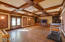 Giant Media Room with wood floors and stunning coffered ceilings